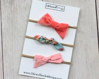 set of 3 Nylon Headbands with a Light Blue Floral, Coral, and Pink Bows