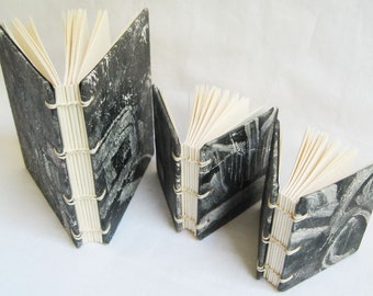 Small handmade notebooks, set of three blank books with black and white monoprint covers, unlined paper