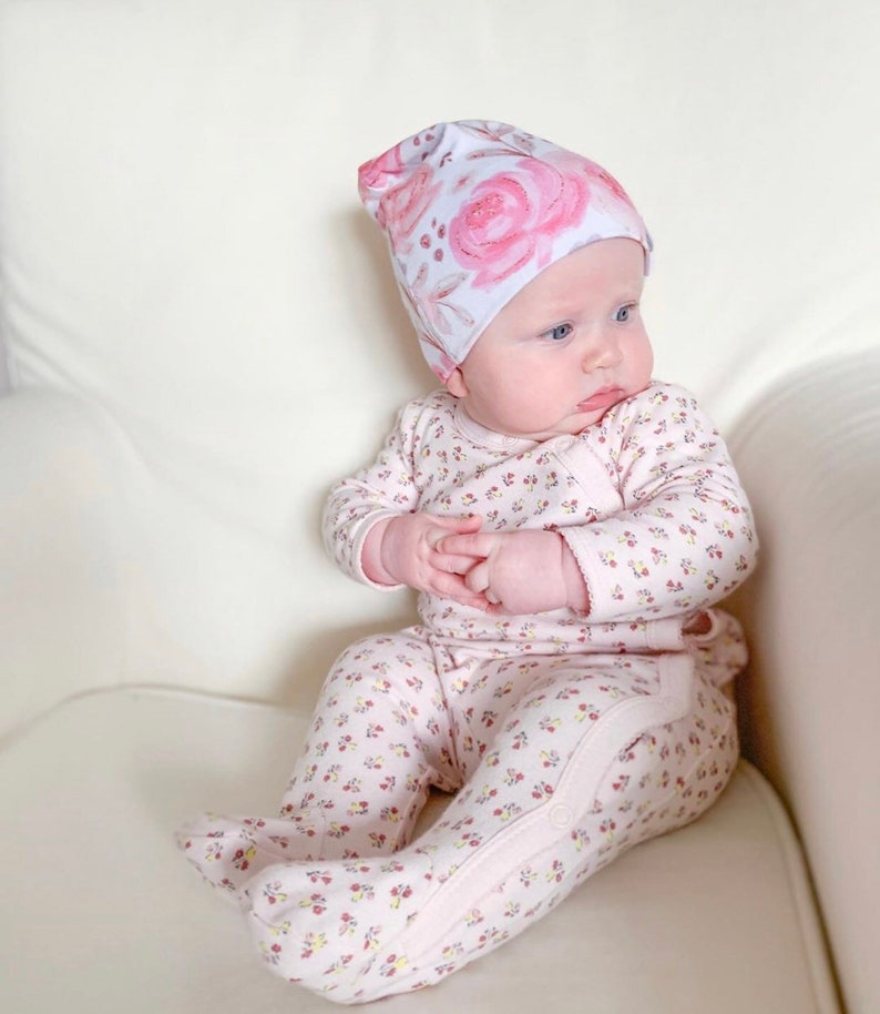 Newborn slouch beanie in pink floral jersey knit