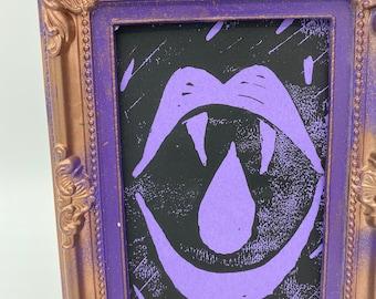 Vampire Teeth Gothic Horror Purple Lino Print With Frame.