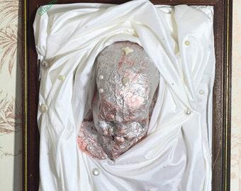 3d Pink Glitter Skull in a Frame. Old Fashioned Creepy Shroud Artwork.