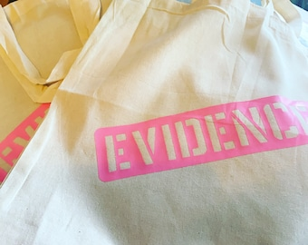 Evidence Bag Tote. Available in Black print or Pink Print. Eco carrier, reusable shopper.