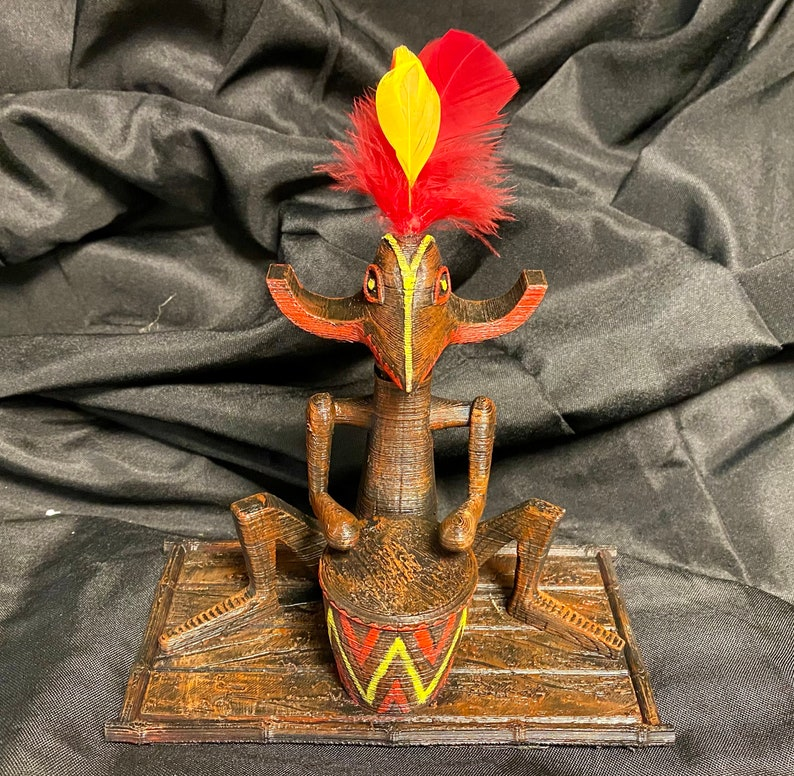 Large Center Tiki Drummer with feathers inspired by the image 0