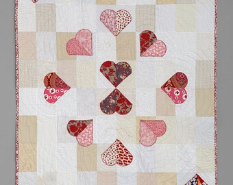 Ten of Hearts: a playing card quilt handmade red and white quilted bedding for your bedroom bed cover or living room throw