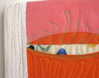Fire Shiner- a small wall quilt, wall art, fishing lure, eyeball, surfboard, fire, lashes, swirls, fiber design, fabric decor