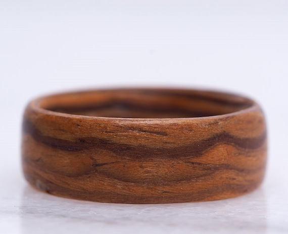 Handcrafted ring made of zebrano wood. Men promise ring handmade in Canada
