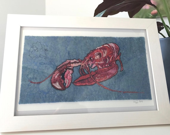 Hand embroidered, felted and indigo dyed fiber art lobster. Made out of hand dyed Merino Wool, Tussah silk, silk threats and embroidery yarn