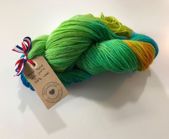 Hand dyed fine wool yarn in blue, yellow and green.
