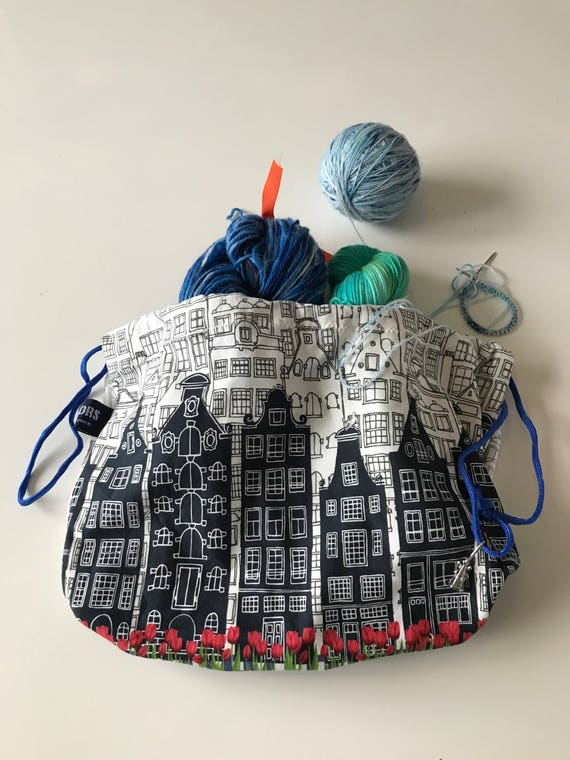 Dutch houses and tulips printed jersey drawstring project bag with boxed bottom.