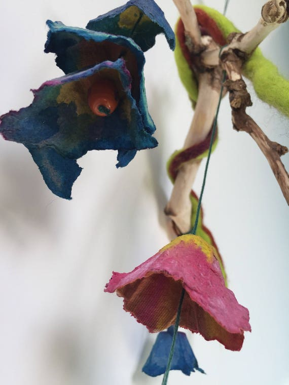 Hand painted, felted and carved mobile. Flowers on an Elderwood branch.