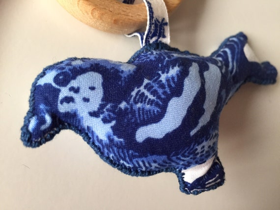 Delft blue sparrow teething and rattle toy on a beech bird shaped ring.