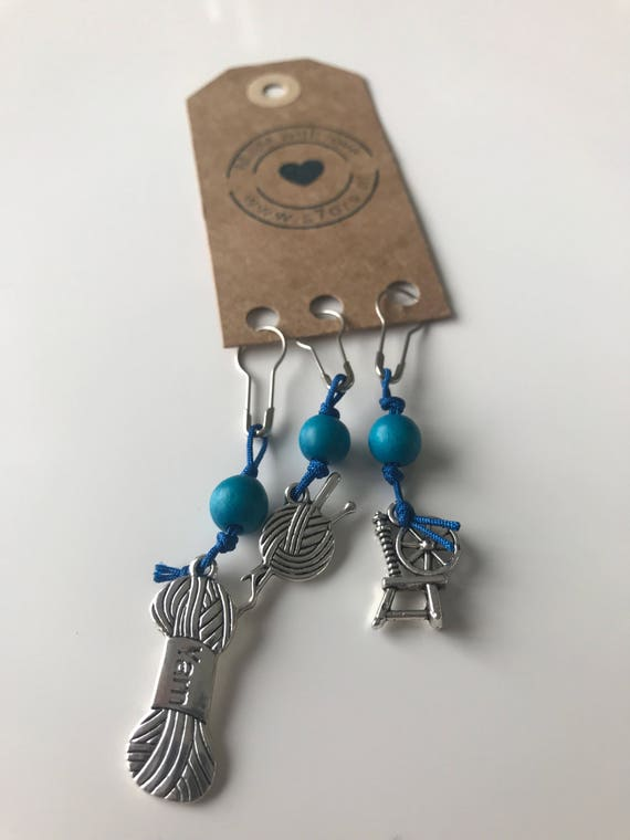 3 yarn inspired stitch markers. With siver, white or blue bulb safety pins.