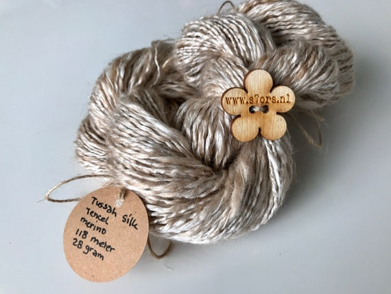 Mini skein hand spun tussah silk, tencel and merino blend yarn. Lace weight. In natural beige.