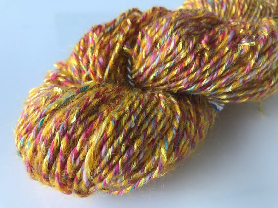Fine hand spun artyarn yellow, pink and blue with spangles