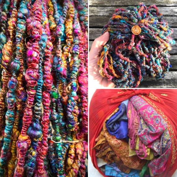 Hand spun sari silk art yarn. A lovely vibrant coloured yarn with the typical crispy soft feeling of sari silk.
