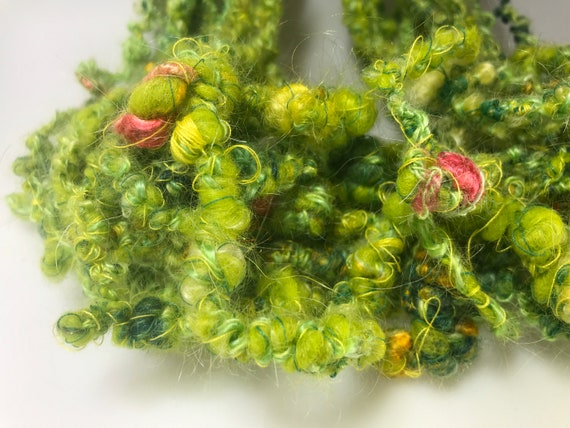 The green grass of home hand spun art yarn. With silk, mohair, locks, thread, angelina glitter and Merino wool.