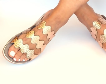 Pink gold sandals with zick zack design, Bubble patterned sole pairs with the signature flexible design for all day comfort and ease