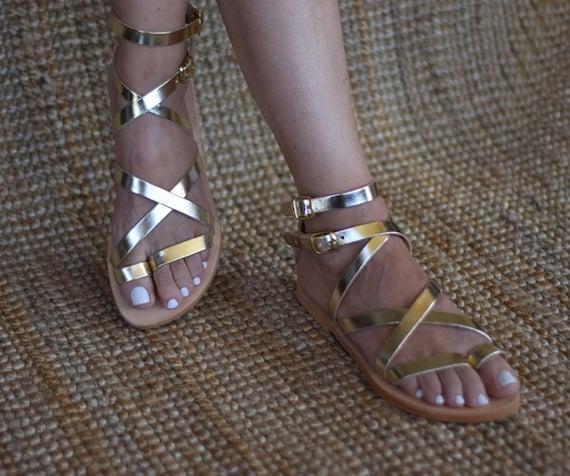 462a264e1e4601 Sexy gold sandals Belladonna in Spartan design.