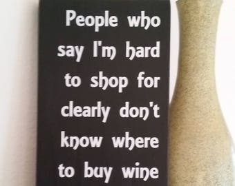 People who say I'm hard to shop for clearly don't know where to buy wine, wine lover, wine lover gift, wine glass, wood sign, bar decor