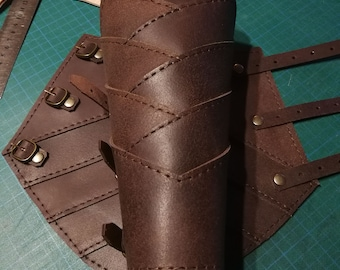 Bracers sewn from straps