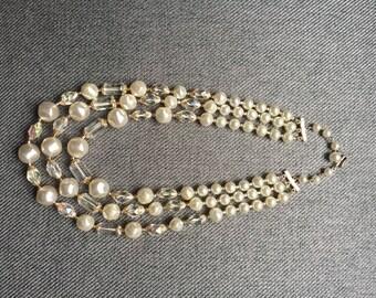 Vintage 1960s faux pearl triple necklace.