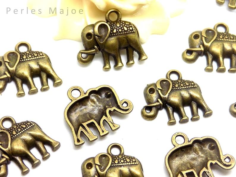 6 breloques pendentifs forme bic couleur bronze dimensions 34 x 5 mm