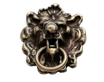 Lion head antique knocker