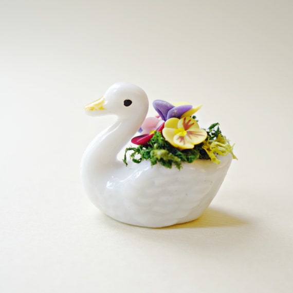Pansies in swan planter