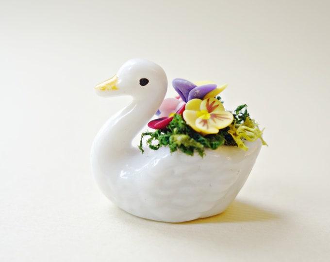 Pansies in swan planter