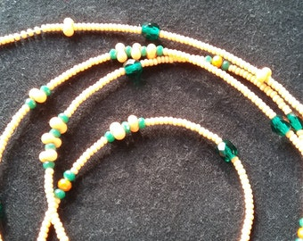 Opaque orange custom made waist beads with crystals stranded on beading wire, read item details and leave size