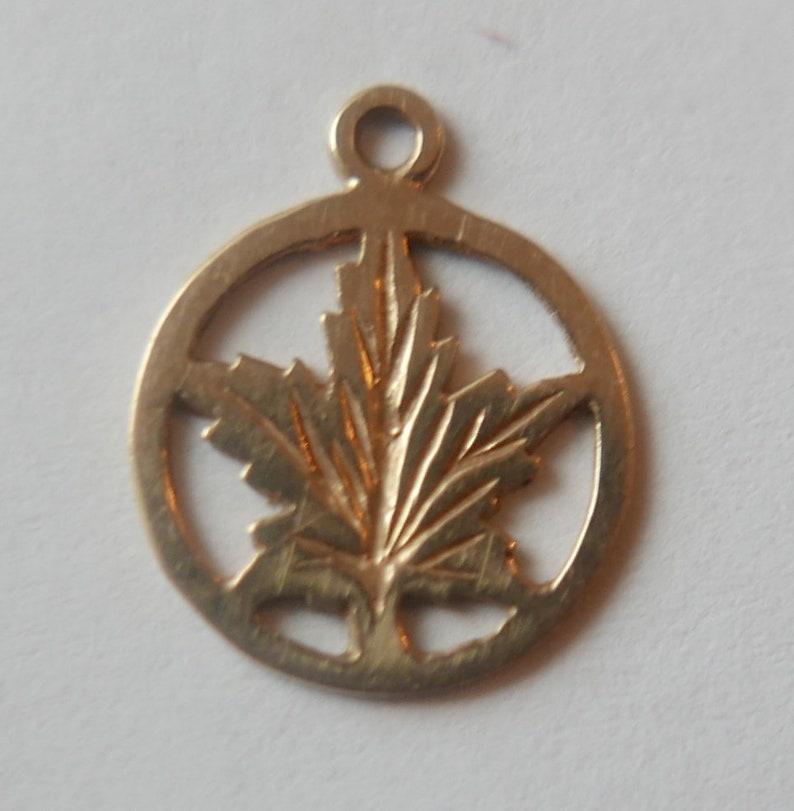 Vintage 10 karat Gold Canadian Maple Leaf Bracelet Charm 16mm x 13mm.