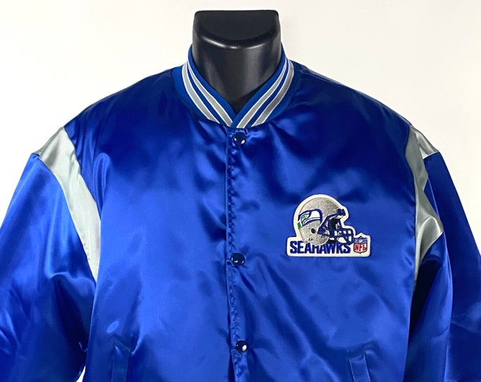 Featured listing image: Vintage 1980's // Seattle Seahawks Jacket // Swingster // Owens Corning Fiberglas // Large // Made USA // Blue // Snap Up // Promo