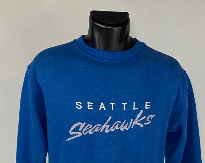 Featured listing image: Vintage 1980's // Seattle Seahawks Crew Neck Sweatshirt // Medium // Blue // Long Sleeve