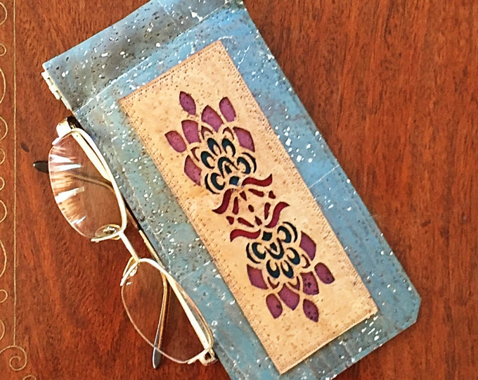 Silver flecked blue  cork leather/cork fabric spectacles/glasses case with a beige appliqué and a squeezy spring closure - vegan case