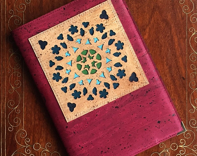 Red cork vegan leather covered A5 notebook with geometric laser cut appliqué, inspired by a rose window, backed with coloured leathers