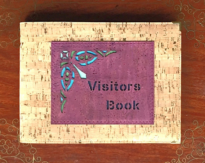 A5 landscape visitor/guest book covered in gold-flecked beige cork leather/cork fabric with a laser cut geometric appliqué: vegan friendly