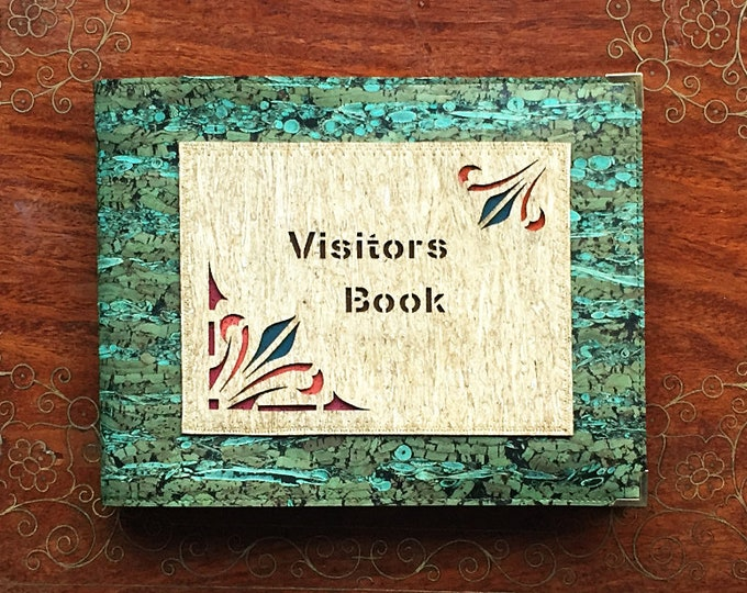 Vegan green cork and fennel leather/fabric covered 5 landscape visitors/guest book with a laser cut geometric appliqué: art paper insert
