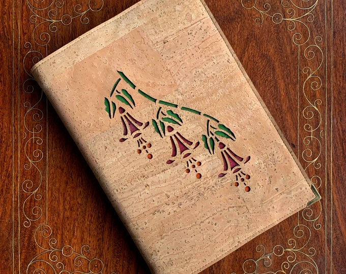 Beige vegan cork fabric A5 notebook - laser cut fuchsia flowers backed in red, green and orange cork leathers