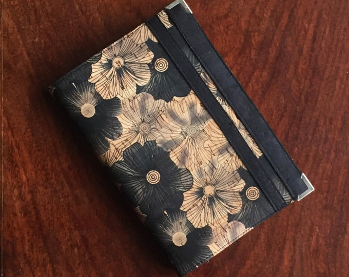 A6 vegan notebook - cork fabric printed with black flowers and two black decorative bands- eco-friendly  cork leather