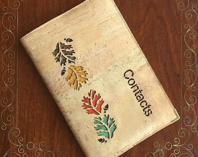 Pale fawn cork leather/cork fabric midi address/contacts book enhanced with an oak leaves design representing four seasons -  vegan friendly
