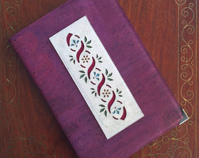 Purple cork leather covered A5 book with an appliqué of a curling ribbon, leaves and flowers - vegan friendly
