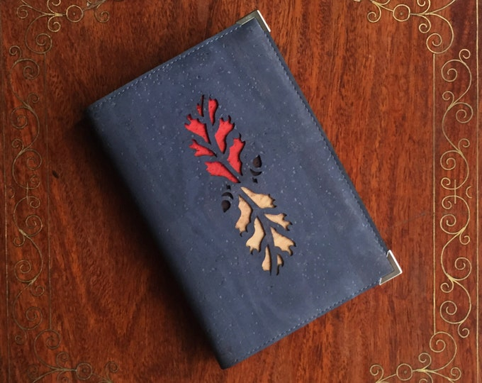 A6 notebook covered in vegan grey cork fabric - cork leather  -  laser cut design of autumn oak leaves backed with  coloured cork