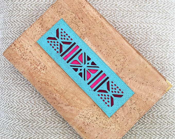 Eco-friendly fawn cork leather A5 notebook enhanced with an applique of an African pattern in light blue backed in coloured leathers