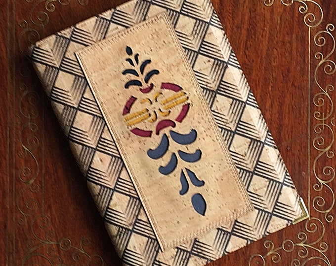 A pretty A5 notebook covered with a diamond patterned beige cork leather decorated with a laser cut geometric appliqué - vegan friendly