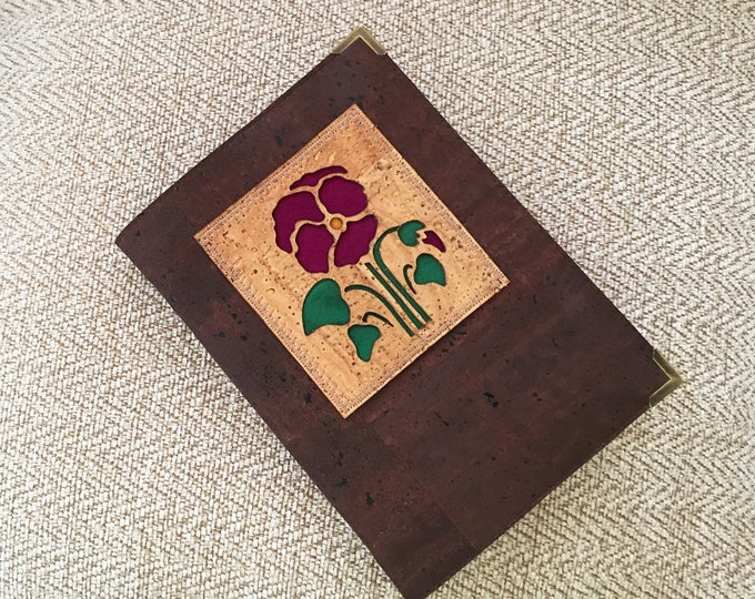 Chocolate brown cork leather/cork fabric A6 notebook with a laser cut natural cork applique of a purple pansy and bud