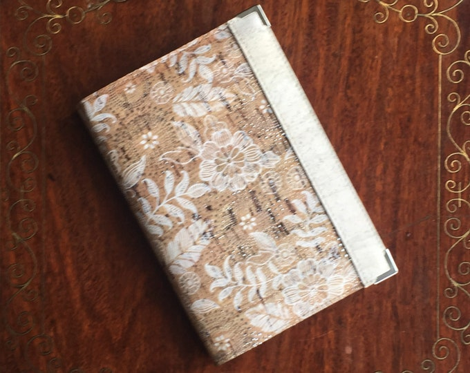 Vegan A6 cork fabric/cork leather notebook - beige cork with white flowers print and silver circles - white band side decoration