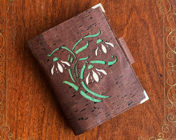 Brown, vegan, cork fabric travel wallet for passport, travel cards, train tickets, boarding passes, cash - with laser cut snowdrops