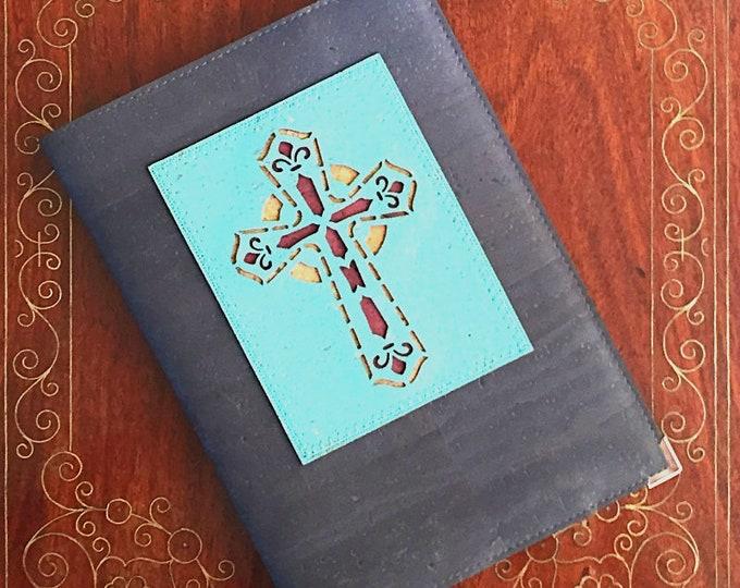 Grey cork leather vegan A5 notebook enhanced with a light blue appliqué of a cross - faith/ordination/confirmation/first communion