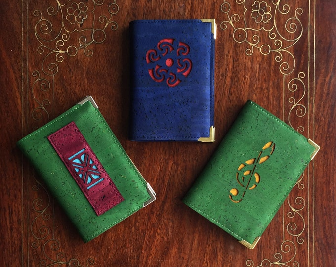 A7 mini notebooks - forest green and blue cork fabric/leather - design of  treble clef/Celtic circle/African cloth