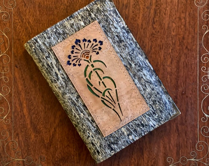 Vegan, cork and straw fabric A6 notebook - beige appliqué of a stylised agapanthus flower backed with coloured cork